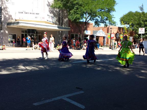 Hispanic dancers in colorful dresses