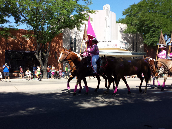 Horses with pink riders