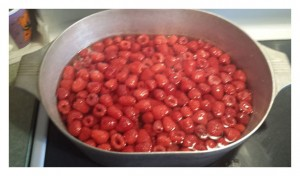 Raspberries in the pot for cooking syrup